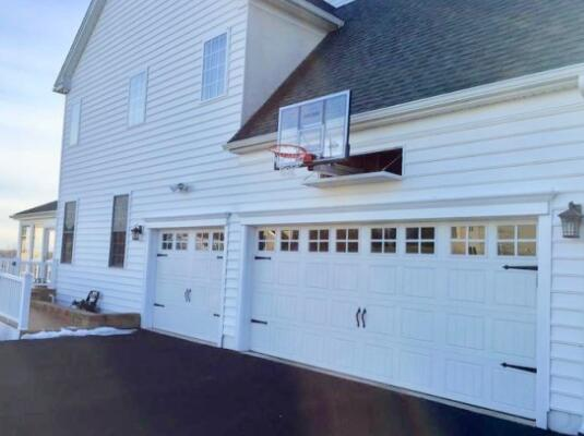 basketball hoop above garage door