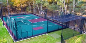 backyard court with batting cages