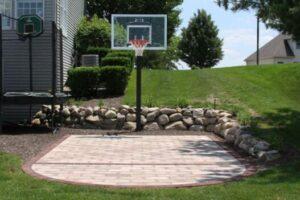 stone backyard basketball court